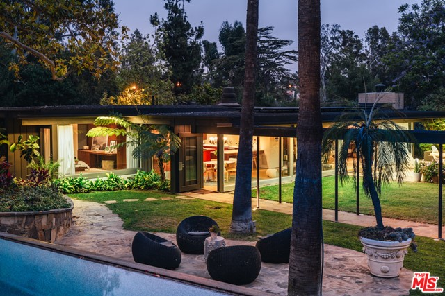 Own a part of history. An idyllic private sanctuary awaits you in the heart of the Pacific Palisades. The property features 2 residences: Richard Neutras Case Study House #20, The Bailey House, renovated and restored by Marmol Radziner and a contemporary LEED Gold Certified main house. Neutra, the most significant and respected architect to participate in the Case Study, designed the house with simple lines and modular interiors that seamlessly open up to the elegant grounds. Expertly situated above The Bailey House, the main house exudes effortless elegance, incorporating open archways, soaring ceilings with emphasis on natural light to give you an unmatched feeling of serenity with the latest in solar and toxin-free construction. This remarkable compound is sited on over an acre of lush manicured grounds that feature a koi pond, wine cellar, fire pit, pool, hot tub, roof top deck with views parking for 20+ cars, and 2 entrances.Possibility to build apx 3,000 sq ft additional home.