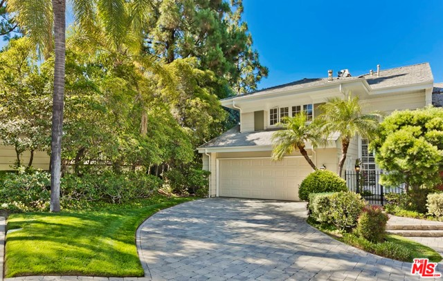 Impressive Garden Villa in 24HR guard gated Mountaingate. Enjoy resort-like living in this rarely found, 2BR+Den+2.50BA end-unit townhome w/beautiful scenic views. Gorgeous, huge wrap-around backyard, lovely gardens, grassy lawns & entertainers verandas are like your own private park. Bright & open, the grand-scaled interior features appx 2600sqft, w/dramatic 20ft ceilings, great crown moldings & HW flrs. Warm & inviting, the Living Rm & Dining Rm provide a perfect backdrop for entertaining. Newly updated corner Kitchen & a spacious Den. The garden-side MasterSuite opens directly to the bkyd w/2 walk-in closets & updated bath. 2nd bedrm is fabulously designed as an in-home office, w/convenient Murphy bed for guests. 2-carGAR+large driveway for addl parking. Conveniently located next to community pool/spa... Its like having your own pool without the maintenance!  HOA dues incl exterior Fire & EQ insurance. Mountaingate is known for its park-like ambiance & spectacular hiking trails
