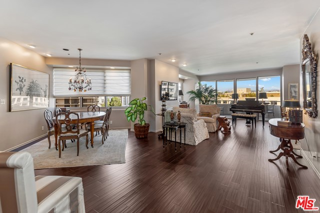 Elegant, completely remodeled unit in the full service TenFiveSixty Wilshire!  Designer owned, this 2 BD plus den with 2.5 baths is waiting for you!  The living room has new dark wood floors, double paned windows, fireplace, and wonderful semi-circle balcony.  Stunning views. The living room opens into the den, giving you lots of spacious luxury for entertaining.  Cooks kitchen is remodeled with all new appliances, Caesarstone counters & beautiful designer subway tiles. The kitchen cabinets all roll out and have soft touch closures. The powder room is gorgeous with walls that come from the ceiling of a Japanese Temple.  Master suite is spacious with remodeled bath and huge walk-in closet. Second bedroom with beautiful remodeled bath.  Extra storage. 24 hour security and valet, pool, gym & social room. Newly decorated lobby and hallways!