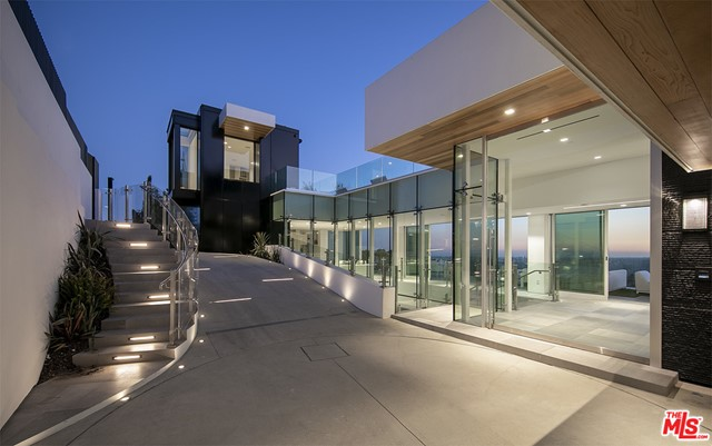 """""""Touch the Sky"""". Epic view modern compound on world-famous Blue Jay Way. Brand new 2020 construction. Approx. 11,500sqft with massive 3,000sqft pool deck and zero edge infinity pool. Walls of glass open to reveal panoramic jetliner views. Private gated driveway lead to glamorous arrival motor court. Beyond is a 3-story glass atrium in the style of an Apple store, wow on every level. Main entertaining level encompasses living room, dining room and a show kitchen designed by Dada complete with walk-in refrigerator and hidden catering kitchen. Grand Master suite with a closet to rival any major estate in the city. Additional living amenities include: wellness center with gym, juice bar and massage, screening room, commercial elevator, 2 offices and a total of 5 bedrooms. Architectural features include: Fleetwood doors throughout, closets by Molteni, Dornbracht fixtures and solid concrete construction. Years in the making... once in a generation opportunity."""