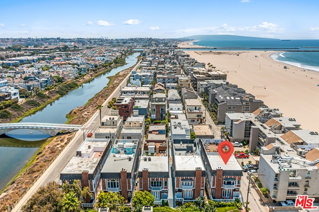 Hard to find 4 bedroom, 3 bathroom condominium located on a walk street, just one building from the sand on the exclusive Marina Peninsula. This first floor unit features: formal entry; step down living room with high ceilings, great walls for art and wonderful daylight, fireplace and large French doors that open to a balcony with views of the ocean and of greenery; formal dining room that opens to the living room; kitchen with stainless steel appliances and marble counters; 4 beds, 3 baths, including a primary bedroom suite with fireplace, walk-in closet, balcony and oversized bath with dual sinks, spa tub and separate shower. The fourth bedroom has its own private entrance and built-in desk, perfect for a home office. Crisp white walls, volume spaces, plantation shutters and 3 garaged parking spaces.  Only two units in the complex which is located on the corner of Speedway/Ketch, offering extra daylight, and breathing room, and near instant access to the sand and sea!