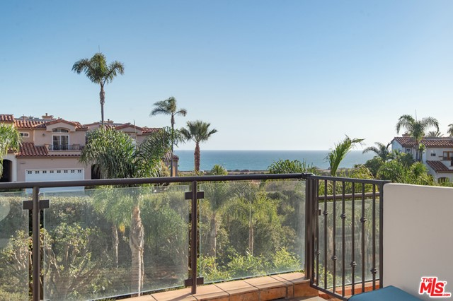 Stunning ocean views from this beautiful townhome located in the highly sought after Vista Pacifica at Broad Beach. This beautifully maintained townhome is set in an ideal location in the center of the complex where you look directly through the lush ravine to the unobstructed ocean views. The entry level features an open floor plan with stone flooring throughout, kitchen with updated stainless steel appliances opening up to the dining area and living room with high ceilings, fireplace and expansive patio with ocean views. Upstairs includes the master bedroom with vaulted ceilings, fireplace, private ocean view deck, walk in closet and master bath with spa and separate shower. Upstairs also includes the second bedroom with its own private patio and in suite bathroom with spa. Vista Pacifica is beautifully maintained with lush landscaping, large pool, spa and gym behind the gated entry. This is the best buy in Malibu with incredible ocean views.
