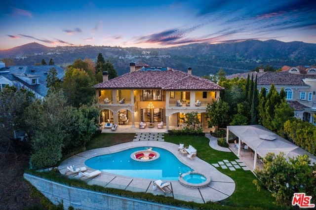 """Welcome to this extravagant Mediterranean Style 16,634 sqft home of 8 beds, 12 baths and a lot size of almost 25,000 sqft. Beautifully located in the most highly sought after prestigious 24-hour guard-gated community in BEL AIR CREST. This remarkable dream home boasts a grand entry, brilliant bright interior with elegant accents. The upstairs hallway features a cathedral style ceiling. A gorgeous Master bedroom and a separate HIS & HERS master bath and private balcony. Theres more to love from a convenient Elevator, a superb 8+ Car garage, Spa, Gym, theater,""""smart house"""" wine room, designer pool, Gourmet kitchen, and expansive entertainment areas. Enjoy privacy and excellence with all the great amenities for residents in the Bel Air Crest Community. You will live amongst breathtaking canyon views complete with tennis courts, a community pool, childrens playground, large clubhouse with fitness center, basketball, dog park and hiking! Close proximity to major freeways. A must see!"""