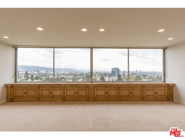 Breathtaking, unobstructed, North/Eastern views of Downtown Los Angeles, Beverly Hills, The Hollywood Sign, and Century City too! Hard to find, corner location, 3 bedrooms, 2.5 baths and 2 balconies. Remodeled condo with gorgeous custom maple cabinets throughout providing fabulous storage. Dazzling granite kitchen plus very pretty baths and powder. Balcony off 2nd bedroom and 3rd bedroom. Full service building, pool, tennis, valet and fitness center. So very easy to show. Minimum one year lease. One dog with 25 pound limit.
