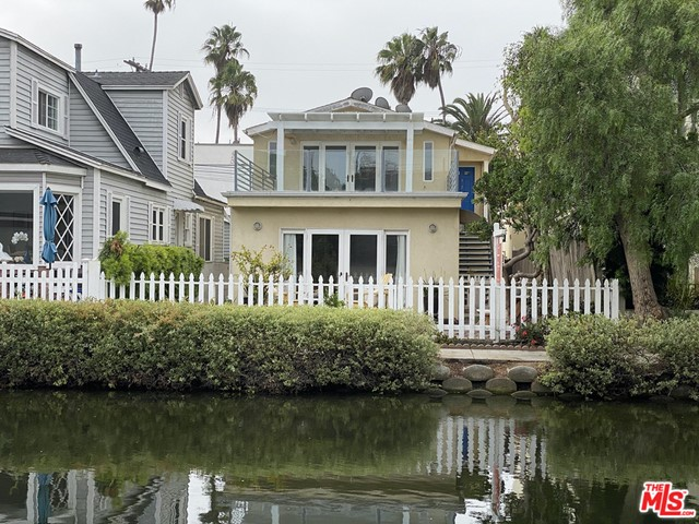 Incredible opportunity to acquire a rare 2-story duplex on an island fronting the Venice Canals! Rebuilt from the studs in 2004, each home is approximately 900 square feet with two bedrooms and one bath, updated kitchens and bathrooms, and wood floors. Both residences have French doors to private outdoor relaxing spaces allowing natural light and ocean breezes to flow. The upstairs flat opens to an expansive terrace overlooking the canal; the downstairs opens to a canal-front deck and yard  perfect for entertaining and indoor-outdoor living.  There is ample parking  5 total spots. Each unit has a private garage and laundry area. This duplex is an excellent prospect for an owner-user or an income property in one of Venice's most desirable locations  on the historical Venice Canals only four blocks to the beach, and Abbot Kinney with its many upscale boutiques, shops, fine dining. The buyer has a blank slate as both units are vacant. Rent out both flats with $100k+ income; live in one and rent out the other; or use all for a single-family abode. Coeur d'Alene Elementary School District.