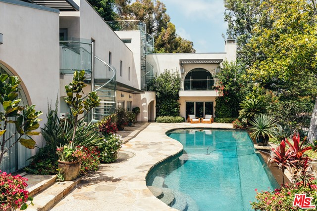 Situated behind the lush private entrance on Corona del Mar, this LEED Gold Certified contemporary home owned by Lorna Jane exudes an effortless California elegance. From the moment you enter the gates you feel as if you have left the city and entered a secluded oasis. Renovated in 2019, Lorna curated an artful transformation of the home, with inspiration from her Sunshine Coast Beach House in Australia, creating a sanctuary to recharge and unwind. The attention to detail is unmatched. You will find natural materials such as oiled white oak, wool, nubby linens, delicate mother of pearl and wooden bead trimmings, jute and aged limestone. The neutral tones of the home not only complement the views of the gardens that are accessible from every room, but accentuate the soaring ceilings adorned by radiant natural light. This estate is the acme of indoor outdoor living, sold designer furnished and features a home theater, koi pond, 2,000+ bottle wine cellar, saltwater pool and hot tub.