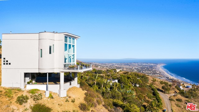 This custom modern Malibu ocean view estate is perched at the top of Trancas Canyon on approx. 2.8  acres boasting extraordinary views of the Malibu coastline from Point Dume to Zuma Beach, the Channel Islands, and beyond. 5 bed, 5 baths, (3 bedrooms and 4 baths in the main house and 2 bed 1 bath in guest house) plus a detached 4 car garage.  Great compound with excellent vacation rental potential.  The versatile floor plan is perfect for entertaining with spacious main rooms, large patios, and separate guest quarters. This beautiful Malibu estate features a detached guest house, a private pool, sauna, a two-story master suite,  sun decks, security gates, a fire protection system, and views from all almost every corner of the lushly landscaped property. It's the perfect Malibu getaway and only 2 miles to Zuma beach and local shopping, restaurants, and schools.