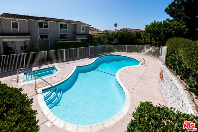 Ocean View - clean updated Townhome in Malibu's private guard gated Malibu Villas Complex.  Front row and a corner unit!  There is an open split level design; on the first floor, this quiet clean condo has been updated with new kitchen appliances, beautiful bamboo flooring in the living room and two bedrooms.  Enjoy a large patio overlooking the garden and an additional atrium pat off the dining room and kitchen, which is great for barbeque. Upstairs there are two bedrooms with vaulted cielings and their own private baths. The master has a walk in closet, deck and views of the ocean!   Attached two car garage with washer/dryer and plenty of storage space. Complex amenities include guard gated entry, community pool, spa and clubhouse.  Paradise Cove, Pier and Cafe across the street.  Close proximity to Pepperdine, Shopping, Hiking Trails, Public Schools and Malibu's iconic beach.