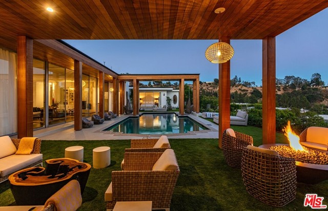 This mid-century modern oasis is your once in a lifetime opportunity to live in the most sought after location in all of Beverly Hills, the one and only Trousdale Estates. Explosive jetliner views from DTLA to Beverly Hills, Century City to the Pacific Ocean and sunset views of the Getty. A seamless indoor/outdoor floor plan includes large oversized master suite with a fireplace, lounge area and dual master baths & closets. This one-of-a-kind entertainer's paradise features a large patio and outdoor lounge area with fire pit, pool, BBQ, bar and an oversized motor court with room for 10 cars. Live the life you've always dreamed of in the most prestigious zip code in the world.