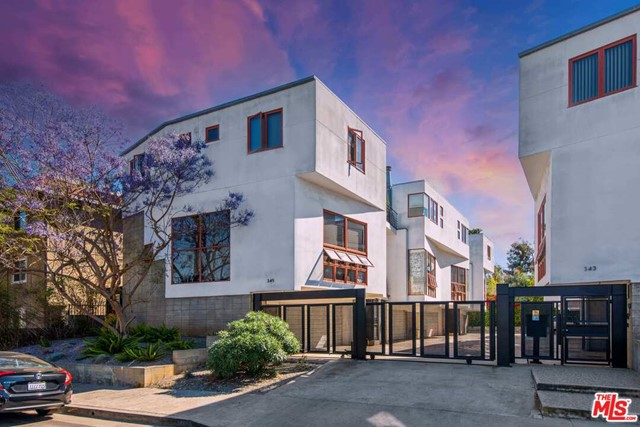 Gorgeous, contemporary townhome in the heart of iconic Venice Beach with a coveted roof top deck for endless al fresco living. Gated and secure, the home offers a private garage and is just steps to trendy Rose restaurants, Main Street, and the beach. Enter to a welcoming open floor plan for a gracious flow through the kitchen, dining, and living spaces accented by a fireplace and grand windows for an abundance of California sunshine. Cook up your favorite snacks and meals in the sleek kitchen with stainless steel appliance, ample cabinetry, and breakfast bar. Be led to the second level where youll find a bedroom, perfect for office, nursery, or guest space, and the well-appointed primary suite with luxurious bath and direct balcony access. A true coastal dream, this Venice Beach oasis has everything you are looking for!