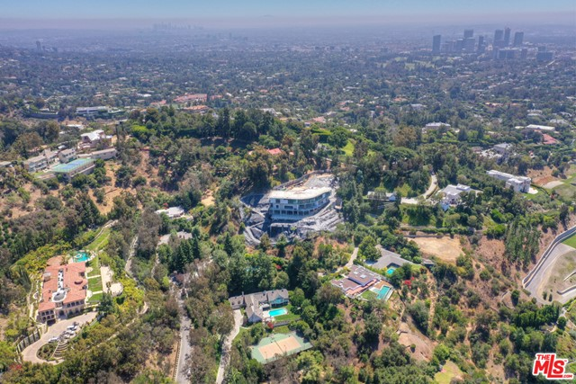 Situated in the sought-after Lower Bel Air and surrounded by some of the City's most celebrated estates, 901 Strada Vecchia Road is a rare opportunity to build a world class estate featuring views of the city and surrounding canyon. Comprising over an acre of land, this property, which is located at the end of a quiet cul-de-sac and approached through manicured, tree-lined streets, offers unrivaled privacy and seclusion whilst being conveniently located within close proximity to the exclusive Bel Air Country Club as well as the world-renowned restaurants and boutiques of Downtown Beverly Hills.The property is being offered as a receivership sale. The current structure will be demolished by the receiver, following close of escrow at no additional cost to the buyer.