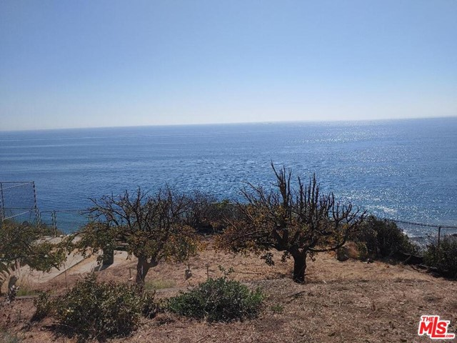 Rare, large 2.57 acre Malibu bluff property with unobstructed and breathtaking ocean views. See sunrises over Santa Monica and sunsets over Point Dume! Diamond in the rough with over four hundred linear feet of bluff frontage. Pool and tennis court, all with panoramic ocean views, great for parties. Property is behind gates with ample parking for guests with a 3 car attached garage. Lots of usable land. Single level large home with high ceilings and a huge living room. Big chef's kitchen has two stoves and a large island. Large dining room. Big primary bedroom w/ fireplace and large attached bath and walk-in closet. Five secondary bedrooms and a study. Close to beach, shopping and Santa Monica. This is a dream property for cash buyers, contractors or developers as the property cannot obtain financing due to being a major fixer. Property can be transformed into a phenomenal paradise. Great upside potential and super value for those who love huge ocean views and privacy.