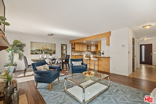 Spacious 3-bedroom 2.5 bath + loft townhome with a private roof-top deck in the coveted Franklin School district. This south and north facing unit has an inviting stone entry that flows to an over-sized living room with high ceilings and a stacked stone gas fireplace. Two sets of French doors let in an abundance of light and lead to a generous south facing patio equipped with electricity, water, and gas making BBQing and outdoor entertaining a breeze. Remodeled kitchen with considerable cabinet and counter space looks out to dining area and living room. Dry bar off kitchen was built in 2014 with two wine fridges and overlooks the living room. Side-by-side laundry in closet and remodeled powder room complete the first floor. All three bedrooms up. Primary suite with sky-high ceilings and wonderful loft with French doors opening to a private south facing roof-top deck with glorious city views. Loft has extra-large closet/storage room. Remodeled primary bath has an epic rainfall shower with two sets of wall jets and separate soaking tub. Two good-sized bedrooms and remodeled  bath are also up. All closets are professionally organized, and built-in cabinets throughout provide a vast amount of storage. More storage space in the private, 2-car garage with direct entry. Fantastic townhome located in a small, five unit building North of Wilshire. Close to shops and restaurants on Montana Avenue and Wilshire Blvd. HOA dues include earthquake insurance.