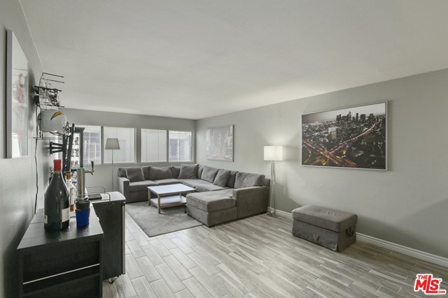 Beautiful quiet penthouse in coveted Hancock Park neighborhood, ideally located & near trendy Larchmont Village! Spacious & renovated with open floor plan, high ceilings, upgraded flooring with elegant high baseboards, & modern color tones. Kitchen with a breakfast nook & bar, has fresh white cabinetry, matching stainless steel appliances for all your cooking & entertainment needs. The extra-large bedroom features a walk-in closet, ensuite sink & vanity for your privacy. Bathroom features a shower with glass door over tub & upgraded flooring.  Live in comfort with central AC/heating & bright South-facing windows. Included is a rare two car tandem parking spacewith extra storage above. With HOA approval you may also convert the large walk-in pantry into a laundry area by installing a hook-up. The pet-friendly Hancock Park Plaza community also offers low HOA dues (EQ included), pool, sauna, laundry, secure entry & security cameras. Close to shopping, dining, entertainment & recreation.