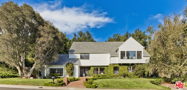 Offers due Nov 12. Set at the end of a flat cul-de-sac, this classic East Coast Trad in the 24-hr guard-gated Palisades Country Estates. This well-designed home offers 4-bdrms, 3-baths + a bonus suite off the garage (ideal office, Zoom-room or guest suite). Large liv rm with vaulted wd beam ceiling & a massive frplc opens to beautiful patio space that extends the indoors. Spacious din rm off updated kit/great rm with walk-in pantry & custom built-ins. The main level is completed by one bdrm, one bath & laundry rm. Upstairs boasts a grand primary suite incl a sitting area, dual walk-in closets, and a lrg spa-inspired bath. The upper level also enjoys two additional bedrooms w/generous closet space plus shared hall bath. French drs off the kit/brkfst lead to a serene brick patio & grass area surrounded by nature and offering complete privacy. Pub rec shows 3,230sqft. Recent measurement = 3,525sqft (incl extra rm/bath off garage). Buyer to verify sq ft, permits, etc.