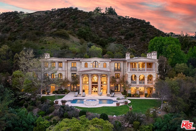 Previously Listed at $23,800,000. Newly reimagined for 2021 with hundreds of thousands in upgrades this Bel Air estate has timeless appeal with a warm, contemporary aesthetic that elevates its existing elegance to a resort at home.   Villa di Ricci, an ultra-exclusive estate nestled in the hills off a semi-private road behind double gates surrounded by dramatic canyon & city light views and just minutes to Sunset Blvd or approximately 20 minutes to both LAX or Van Nuys private airport.  An entertainer's paradise, this estate has an indoor-outdoor resort-style design with multiple terraces, plus 1.5 acres of freshly landscaped grounds creating a tucked sense of privacy that center around a pool with a spa and arcing fountains. Host in the formal living room open to a covered loggia or your choice of a formal dining and wine room; a gourmet kitchen with a breakfast room & service kitchen or linger over drinks in a salon with a restaurant sized bar.  Treat yourself to an in-house spa-styl