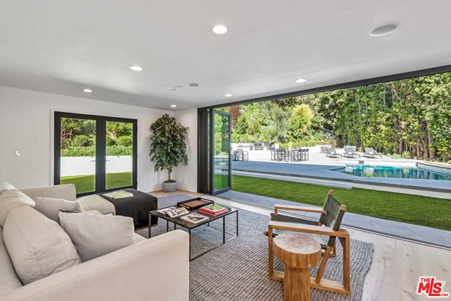 Welcome to The Blantyre House. This modern Spanish Estate, sitting at the end of a cul-de-sac and surrounded by 30-foot tall hedges, provides the utmost privacy. From A to Z, this entire home has been re-imagined with an astonishing level of design. Floor plan has a great flow, ideal for a family, yet with an open and spacious appeal to the modern day buyer. This smart home contains a plethora of features that can be controlled from your smart phone or built-in iPad. Stunning chefs kitchen includes brand new cabinetry, appliances, and leathered marble countertops looking over a center island into the dining room. Huge master bedroom exposed to tons of natural light. Master bath compares to that of your favorite five star hotel with the most serene wet room consisting of dual shower heads, a stand alone tub, skylights and windows, all looking into the yards idyllic hillside. Backyard is an entertainers paradise. Brand new pool, fire pit, and outdoor BBQ and pizza oven.
