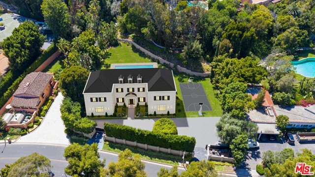 """Private & gated Mediterranean Estate on over 39,000 sq ft of land. Prime Beverly Hills location,  moments to Rodeo Drive and The Beverly Hills Hotel.  Featuring 6 bedrooms and 8 baths, the compound includes a large motor court, vast lawns and large pool. Great sense of space and privacy with the ability to expand the existing residence or build new.  Two privacy gates with lots of parking. The estate can be combined with """"The Beverly House"""" for a total of 4.4 acres, this property provides a once in a lifetime opportunity."""