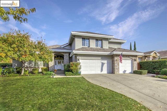 CLASSICAL CUSTOM ELEGANCE IN APPLE HILL ESTATES! Almost 3,300 sf PLUS a play room/storage room upstairs that's not included in that sf. Primary bedroom is downstairs. Has TWO walk-in closets! Retreat off of primary bedroom makes for a great home office! Cozy double-sided gas-burning fireplace in family room and in retreat. EXTRA-large bedroom upstairs is about 18' X 17'. Large kitchen with stainless appliances, trash compacter and custom pendant lighting. Gleaming real hardwood floors in entry, hallway and kitchen. Upgraded plush carpeting. Light, bright and immaculate. Crown moulding in many rooms. Jetted tub in primary bath. Soaring ceilings in grand entrance. Built-in speakers in family room. Plantation shutters. HVAC, stove, oven, microwave, dishwasher and water heater all replaced since 2015. Large cement rear patio and grassy area plus play structure. Motorized shade awnings. Back-up generator is included. No direct rear neighbors and mature landscaping provide a sense of privacy