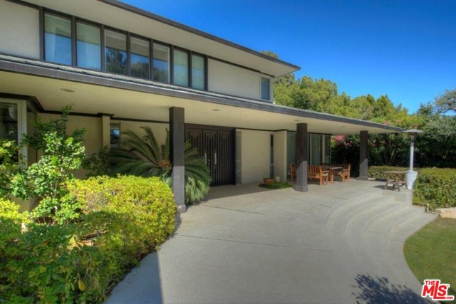 Privately nestled on Billionaires Road on Beverly Hills most coveted desirable cul-de-sac North of Sunset Boulevard. Mid-century style, 3-story with approximately 5,600 sq. ft. on 20,364 sq. ft. Lot with 96 ft. frontage x 210 ft. depth, great open floor plan with 5 bedrooms, 6 baths, formal living, dining room, large open kitchen, family room, sunroom, laundry room, large basement bonus room perfect for child's playroom, movie theater, or additional family room, large pool, child's play gym, basketball court, putting green, beautiful landscaping, 2-car garage plus 2-carport, set behind gates offering privacy and security. Perfect celebrity hideout. Close to all of Beverly Hills finest restaurants, shopping and hotels.