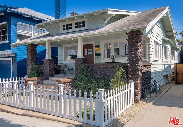 A wonderful and rare opportunity to own this one-of-a kind two-unit beach property in Santa Monica's historic seaside community of Ocean Park. Fraser is one of 5 tree lined streets dotted with a mix of beautifully preserved colorful cottages and bungalows that have been in demand since the lots were first sold in 1901. This coveted neighborhood is steeped in history and elegance and  this is the chance to make it your own. The 2BD/2BA craftsman front house combines vintage details with updated and fresh beach appeal featuring classic custom built-ins, coffered ceilings and handcrafted wall ledges throughout.  In the front house enjoy great flow from the living room to a formal dining room and updated kitchen. Both bedrooms feature en-suite baths, one with a jetted tub. The charming front porch with ocean views is perfect for dining alfresco and relaxing on long summer nights. The delightful 1BD/1BA rear unit enjoys its own private deck, galley kitchen, separate address, utility and laundry hook ups.  Ideal for live/work, guests, income or investment. And if your vision for this home is otherwise, completing the offering are city approved plans to build an exceptional custom designed 4 bedroom two-story home with an ADU and quaint rear yard.  Watch the sunsets, enjoy the nearby parks and beaches or the shopping, dining and nightlife just a few blocks away.