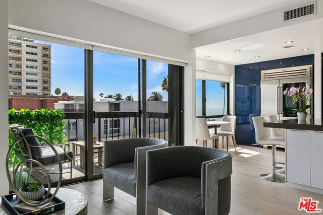 Stunning Ocean Ave condo with ocean and city views in an unbeatable Santa Monica location. Just a stones throw from the beach, the palm-studded Palisades Park, and The Promenade. This 3 bed + 2.5 bath unit has a sun-drenched open floor plan with just over 2,000 sqft, floor-to-ceiling windows, fantastic designer finishes, hardwood floors, and tons of built-in storage. Living room with fireplace, formal dining, and a large eat-in kitchen with Wolf and Subzero appliances, Miele dishwasher, and huge center island. A generous primary suite with en suite bath, marble counters, shower and soaking tub. Two additional spacious bedrooms (one is a den/office that could be used as the third bedroom). Topping it off is a private terrace with white water ocean views. Laundry in-unit, two parking spaces and additional storage in the gated underground garage. This secure building features an exercise room, sauna, steam room & pool -- all in the best location with access to everything Santa Monica has to offer.