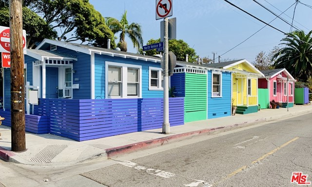 This 3-unit investment opportunity delivers annual income $120,600 and CAP rate of 5.6 on the always-in-demand beach lifestyle! Tenants are drawn in by ocean breezes, sunny skies, and a location thats just blocks from the Venice Boardwalk, canals, and shops & dining at Abbot Kinney & Main St. An exterior clad in bright Caribbean-inspired colors stands out as fun & playful, putting these charming bungalows on the map. Vintage details are found throughout each unit, with wood floors, solid shaker doors, classic hardware, built-in cabinets & cozy fireplaces. Practical upgrades such as recently updated bathrooms and laundry in each unit are tenant must-haves. Unit A features 2 beds/ 2 baths, deeply hued vaulted ceilings, a kitchen with SS counters, &  rustic barn door in the master bedroom. Unit B offers 1 bed/1 bath, with windows bringing in flowing light. Vaulted ceilings & fireplace trimmed in wood are stand-out elements, and the kitchen looks out on a private deck. Unit C is 1 bed/ 1 bath, with a bar counter creating a great hang-out spot that connects the living room, kitchen & dining nook. A bonus mud room opens to a private outdoor space with gorgeous bougainvillea. The bathroom is a pass-through that connects to the bedroom and laundry. Contact us today for a list of recent upgrades, and detailed income information. Showings only with excepted offer