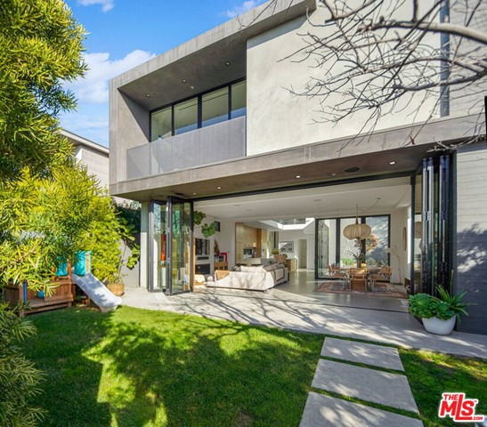 Stunning 4bed+4bath architectural home designed and built by Wylan/James in 2018. On an exceptionally quiet street yet just off Abbot Kinney and a short walk to all the best restaurants and shops. Living and dining areas flow elegantly to kitchen and outdoor patio, spectacular for family and entertaining. White oak cabinets and teak deck create a perfect balance of warmth in this clean modern masterpiece. 760 sq' roof deck, front yard with play structure, side patio with outdoor fireplace, floor to ceiling sliding walls of glass on the main floor lend to a seamless indoor-outdoor lifestyle. Truly the best of Venice.