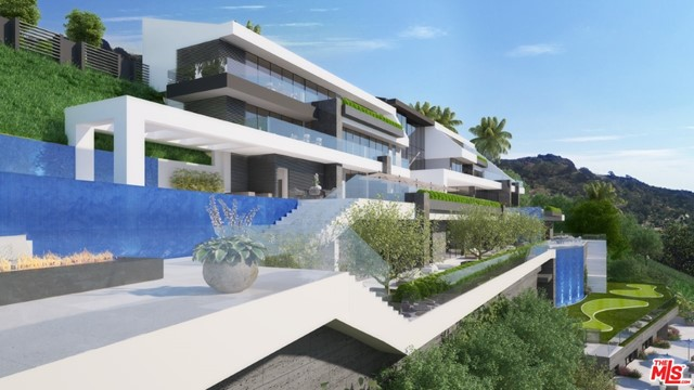 Fantastic development opportunity, on large 3.17 acre lot, with apx. 376 feet of frontage, in prime  Beverly Hills  90210. This multi million dollar setting has panoramic, jetliner, canyon & city views ,extending from Downtown Los Angeles Basin to Century City. Architectural plans for a stunning  contemporary home, by cutting edge Architect Sanam De Loren & Associates, are approved and paid.  Additionally, these  plans have been grandfathered in, giving this 3 acre lot a priceless value.  Plans are for a 30,000 sq ft home, w/ 10 bedrooms,15 baths, 2 elevators & lower level glass auto gallery w/ parking for 20 cars. This iconic home ,currently under construction, by renown hillside builder, Sanam De Loren & Associates,  will be delivered by Seller for $34,950,000. The plans are also in revision for a 10,000-15,000 sqft home, tailored to your specific desires , if you prefer.  3 acres land, completed plans, permits ,also available, as is, under construction for $4,995,000.  $34,950,000  is for completed ,delivered home , 24 mths.