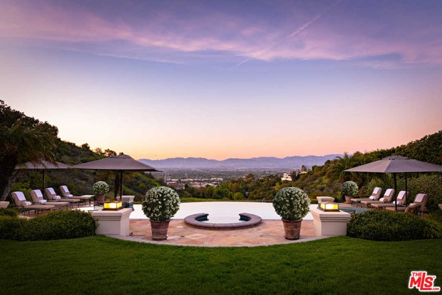 Settled above the city lights, this elegant Tennis Court Estate features approximately 16,000 sq of luxury living all within the coveted 24 hour guard-gated community, Mulholland Estates. Featuring 7 bedrooms, 10 full bathrooms, a formal entry, dining room, expansive sous-chef style kitchen & over sized living/entertaining areas which are rich in character and full of volume. As you walk thru the home, you are greeted with floor to ceiling doors/windows that lead out to the resort-style backyard with an infinity edged pool, tennis court & outdoor dining areas which offer an unparalleled lifestyle of seclusion, luxurious comfort & lavish entertaining. Additional features include a library/office, gym, 10-car garage and an entertainment floor encompassing a home theater, game room & wine area. The classic yet sophisticated home awaits the next buyer to fully experience the Southern California lifestyle at its best.