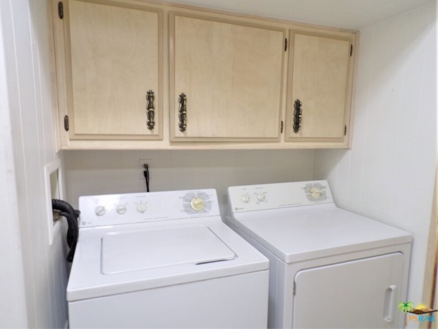 Separate Laundry Room Adds Plenty Of Space & Has Matching GE Washer & Dryer