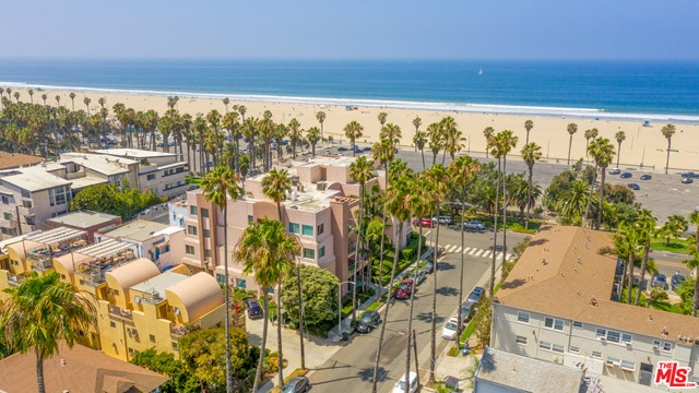 Wake up to the sound of the Pacific Ocean in this rare beachfront condo - located minutes from the water, Main St, local farmers markets, the Santa Monica Pier, and more! See beautiful sunsets sitting in the park or enjoying beach activities. The unit is located on the first floor in a 10 unit boutique condominium featuring a  private gym, courtyard and conference center. Both bedrooms are en-suite with remodeled full baths and new custom closet organizers. Brand new kitchen appointed with a quartz countertop, deep basin sink, shaker-style cabinets and new stainless steel appliances. Separate laundry room in-unit features new energy efficient appliances with built-in cabinetry. Brand new HVAC unit. Two side-by-side parking spaces assigned to the unit with extra private storage and controlled-access to garage and community bike locker. Don't miss this opportunity to be in one of the lowest HOA buildings this close to the ocean.