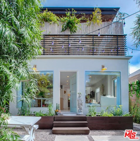 Dynamic Architectural Venice w/mountain & city views.  Enter this sanctuary in the city through a private landscaped garden. Large picture windows showcase the bright+airy 3 bed/3 bath 2-story haven. Nothing was spared on this remodeled illuminated space with aesthetic views.  As you walk in the high grade wide pane steel core windows frame the scenery behind the glass. An Artistic home featuring chef's kitchen with Miele cooktop/oven+dishwasher, SubZero refrigerator, Poliform range hood + pantry. Main bedroom suite features wrap around viewing balcony with outdoor seating area, and the high ceilings optimize space & light.  En suite bath w/glass & tile shower is spaciously appointed. Added bonus - a custom walk in closet.  The 2nd en-suite bedroom with balcony can be used as a creative studio or office. Main floor bedroom perfect for guests. Additionally, the house features dual zoned a/c, security camera/lights, Beyond o2 alkaline water filtration system, on-demand water heater, electronic entry system, garage + add'l parking w/storage.  Located just 2 blocks from the sand & surf and/or the famed Venice Canals. Walk to Abbot Kinney.  Shown by appointment only to pre-qualified clientele.