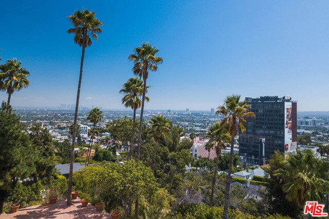 Situated on a promontory overlooking head-on unbelievable city views on over an acre in lower Doheny.  An incredible  opportunity for an owner/user or developer to create an estate-like property in a very prime location. Panoramic 180 degree views from downtown to the ocean.