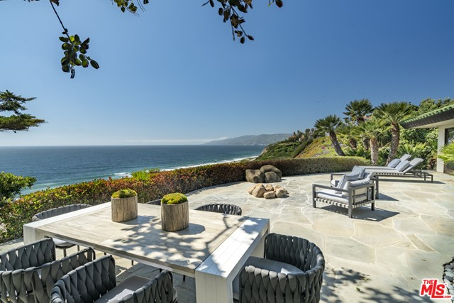 Behind the gates of this private Malibu bluff estate, you will find peace, tranquility, and breathtaking ocean views. Inspired by the design elements of tropical five-star hotels, this open concept home has been carefully thought out to provide the ultimate in indoor/outdoor California living.   The 4 bedroom/5 bathroom main house features an artist loft, state of the art screening room, open concept living, dining, family room, as well as a beautiful chef's kitchen. Sliding doors open to a beautiful patio overlooking one of the most spectacular ocean coast lines known to man. The property also has a one-bedroom guest house featuring a state-of-the art gym overlooking the private lagoon style pool and spa and a private pathway down to the beach. Carefully manicured with some of the most lush plantings in Point Dume, paradise is found in this one of a kind compound.  Virtual/FaceTime tour is available.