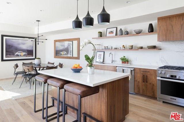 Venice lifestyle, Santa Monica amenities. This signature boutique property sits in the highest demand area of Silicon Beach - on the border of the Ocean Park district (Santa Monica) and Rose Avenue district (Venice). No expense has been spared, the gourmet chefs kitchen features Miele appliances, custom built walnut cabinets, and a large walk-in pantry. The wide plank oak flooring and floor to ceiling windows bring the outdoors in and creates a serene, relaxed feel perfect to entertain and unwind. Enjoy the luxury and convenience of private oversized subterranean 2-car garages.