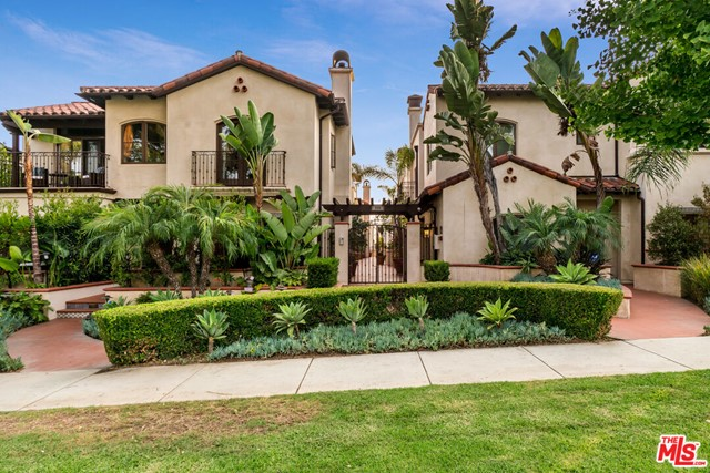Sophisticated three-bedroom Spanish Colonial townhouse well-positioned in prime Santa Monica and the coveted Franklin School District.  Built in 2008, this sun-drenched corner unit is one of 8 private residences nestled within a gated courtyard. Boasting an open concept cooks kitchen, family room with fireplace, dining area, and multiple outdoor spaces, including an impressive rooftop patio with custom glass panels and expansive seating area perfect for enjoying the sunset.   The primary bedroom is on the 2nd level with a fireplace, walk-in closet, and en suite bathroom featuring dual sinks, soaking tub, separate shower, and Juliet balcony. The secondary bedrooms share a hallway bathroom with a sizeable shower. Notable unit features include walnut flooring, wide archways, alder wood doors, and custom tiled patios. The gated vehicle entry leads to private direct access two-car garage with extra storage space. The location is great and just a short distance to Montana Avenue, restaurants, shops, and entertainment.