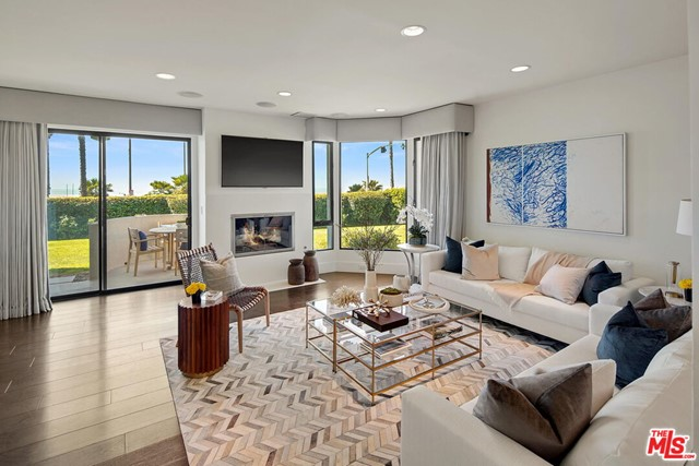Luxury oceanfront residence at the highly coveted front row at Sea Colony One. Enjoy the glistening waves of the Pacific Ocean and spectacular sunsets from this ultra-modern, sensational 3 bedroom, 3 bathroom townhome that has been remodeled with no expense spared. At the touch of a button retract the electric shades in this sophisticated home, step onto the terrace and take advantage of the remarkable, unobstructed ocean, beach and mountain views. Modern luxury at its finest at Santa Monica's premier beach. First floor chef's kitchen opens to dining and family room which leads out to patio and large grassy area. Upstairs has primary retreat with flawless bath, 2 walk-in closets and balcony as well as 2 other bedrooms and a bathroom. Other features include Control 4 system, electronic privacy glass window in primary bath and fireplaces in both living room and primary bedroom. An A+ location, just moments from all the shops and restaurants of Main street and the Promenade while still its own guard gated community.