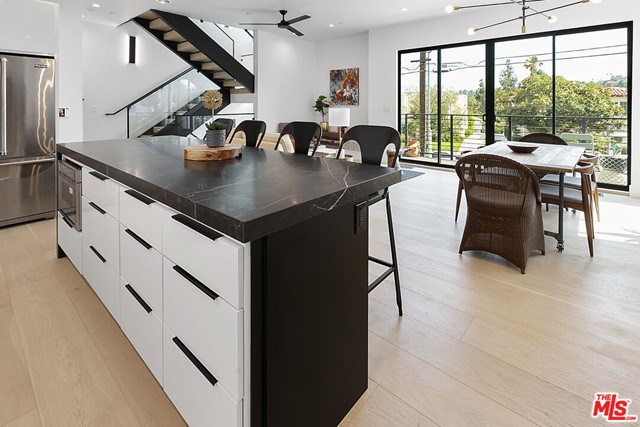 Rowena Walk is an enclave of new structurally independent homes nestled into a hip enclave of Los Feliz with popular shops and eateries moments away.  This 3BD + Office, 3.5BA home inside this boutique collection embodies style, light and function with an abundance of oversized windows and high end finishes at seemingly every turn. The main living level features high ceilings and a seamless, open floor plan with walls of glass to the wrap around private yard. Cook's kitchen featuring Viking appliances, abundant cabinetry and center island. Upstairs find 2 bedrooms and 2 baths including the ample sized primary suite boasting custom dual sink vanity a large shower and walk-in closet. A private roof top deck with gorgeous hillside views caps this private, urban retreat. Curated with high end finishes and materials throughout. Two car garage with direct entry, tankless water heater, dual zone AC/heat and more. Steps from Trader Joes, Sperenza and Barbrix. Ivanhoe Elementary.