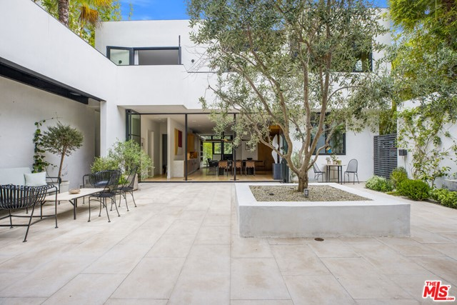 Beautiful contemporary in the highly coveted Santa Monica canyon. This sensational 4 bedroom, 5 bathroom home, completely redone in 2016 and designed by Josh Greene, is surrounded by secluding landscaping with treetop views. Within the home, an alluring and open courtyard takes you out of Santa Monica and into your own personal resort. Greeted with the seclusion of a gate and the grandness of a beautiful oversized door, the home features generous indoor-outdoor dining and entertaining spaces. You will be stunned by the contemporary details abounding with natural light throughout. Entering into the kitchen, one is greeted with a newly renovated, remarkably exquisite kitchen and island featuring top of the line appliances.  Greenery pokes throughout with large windows showcasing the trees and plants the property sits on, including your own private garden where the possibilities of flowers, herbs, and fruits are endless. This sensational contemporary perfectly depicts a life of luxury in Santa Monica all while being mere minutes from the beach.