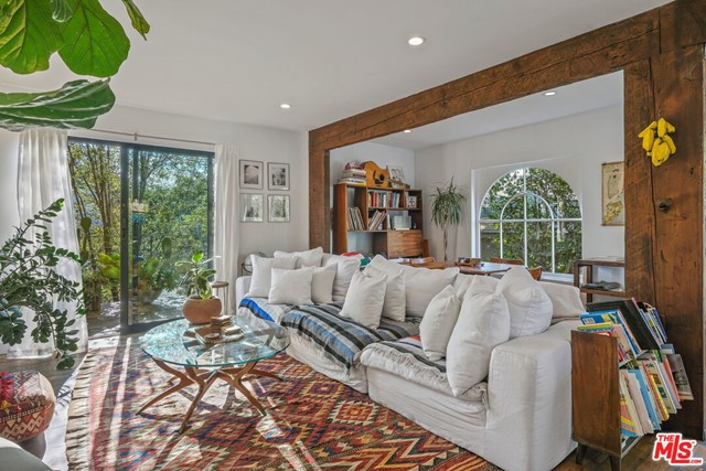 Warm, rustic & deeply soulful with room to breathe. Whether working from home or returning at the end of the day, this 3 bed/3  bath home provides sanctuary. Contemporary upgrades like an open concept kitchen and walls of glass add to the character of this over 100 year old home  with exposed beams in the family room, a wood burning fireplace in the living room, and a wrap around porch. A real dining room with French doors for privacy would also work well as a home office/study. Upstairs, each sunlit bedroom enjoys its own en suite bath, w/ the main bedroom opening onto a large NW facing balcony with views of swaying palm trees-ideal for taking in sunsets or peeking at the stars. Outdoor entertaining is magical in the beautifully landscaped back yard w/ mature fruit trees, outdoor dining & living areas and a built-in barbecue. With lots of street parking, just imagine how you could use the finished, detached 1 car garage/studio (w/full bath)! Just blocks to the beach, dining & shopping