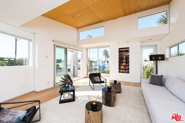 Spectacular Venice masterpiece designed by award-winning Architect, William Adams. Located just off Abbot Kinney and mere seconds to the beach, this stunning corner lot architectural home encompasses the impeccable design and functional living at its best. Comprising of polished concrete floors & large block walls that work to create an industrial ambiance, this sleek 3 story home Infused light streams through the walls of windows & sliders throughout. The first floor resonates as an office flex space w/bi-fold glass & floor to ceiling doors that open onto your front outdoor space. Move onto the master bedroom & bath w/stand-alone Americh tub, oversized steam shower & Graff fixture dual sinks. The 2nd floor also houses the two spacious bdrms & bath. The 3rd floor highlights your living areas w/a Miele stainless kitchen featuring Bulthaup Cabinets, dine-in bar w/ dining areas on each side of the kitchen. Watch the Venice sunsets from your incredible roof deck - this is it!