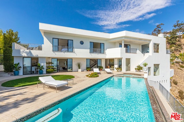 This stunning modern residence is just moments from the famed Sunset Strip and features unobstructed jetliner views from Downtown to the ocean. Set on a separate private drive off Sunset Plaza adds to the privacy and seclusion this estate offers. An open floor plan allows effortless flow throughout the home. The main level showcases a cooks kitchen & breakfast area, dining area, and a generously proportioned living room overlooking the sweeping city vistas. This level leads to the expansive entertainers flat backyard patio with a grassy area and fully equipped with a built-in bar perfect for seamless indoor/outdoor living while enjoying the California lifestyle. A large swimmers infinity pool and spa forge an effortless connection with unobstructed jaw-dropping views of Downtown and beyond. The saltwater treated pool and spa are heated by solar roof panels. The lavish master bedroom suite has a spacious private patio, bar, office, 2 roomy dual walk-in closets, and a cozy sitting area with fireplace to take in the dazzling city lights. 3 additional oversized guest bedrooms with their own en-suite bathrooms and a large sunbathing deck off one of the upstairs bedroom suites. The home also showcases integrated smart home automation, a generous sized media room, gym, and game area on the lower level with a private patio. This exceptional property is not to be missed.